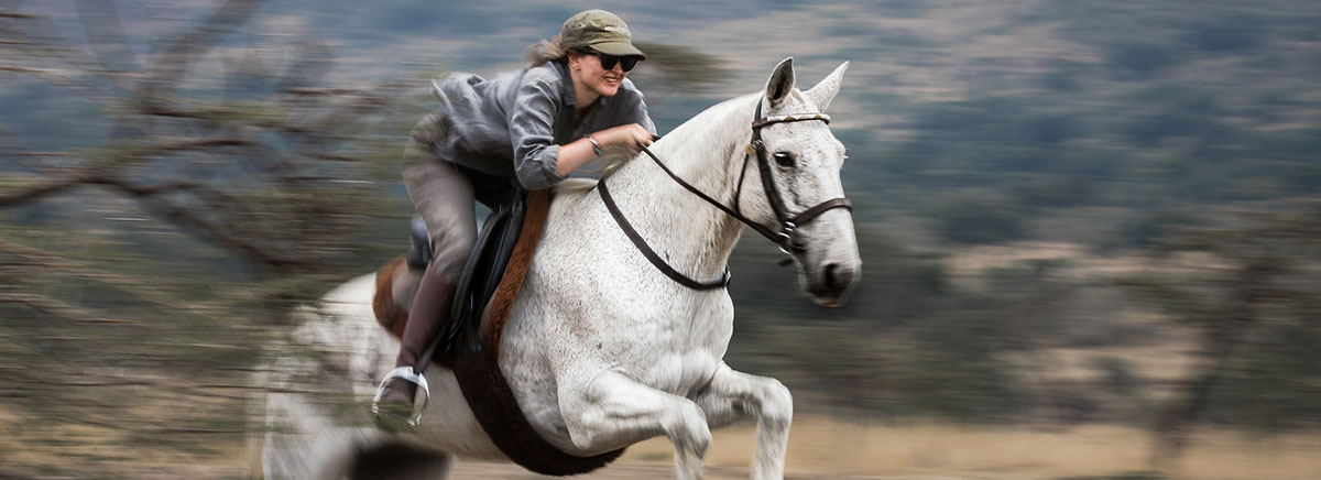 Jumping on Horseback Safaris Unlimited Africa Kenya