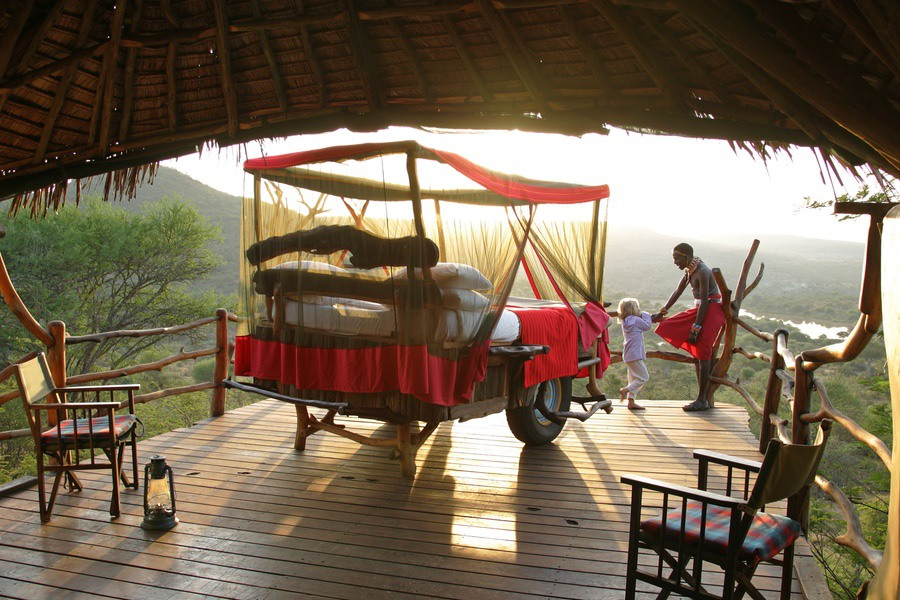 Safaris Unlimited - Loisaba - accommodation - Kiboko Starbeds - little girl & Maasai guide