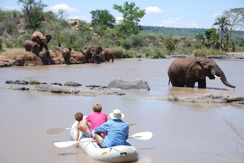 Activities - Boys and elephants kayaking with Safaris Unlimited Africa in Kenya